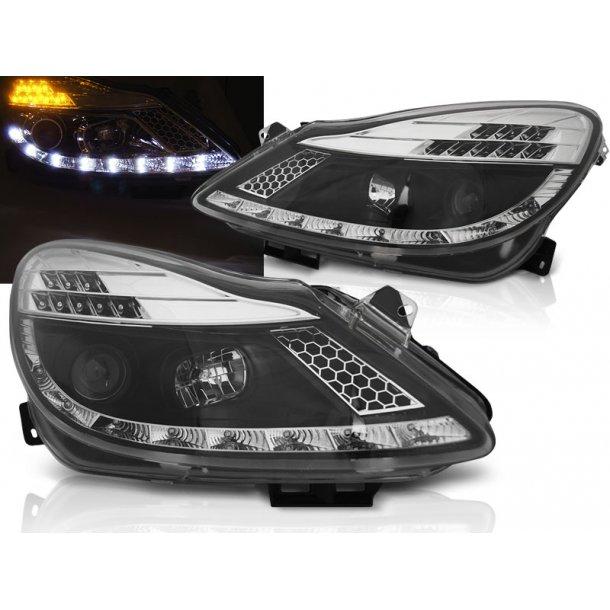 Frontlykter OPEL CORSA D 04.06-11 BLACK LED + PW21W